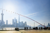 Kite flying along the promenade at The Bund with view of Pudong skyline, Shanghai, Shanghai Shi, Zhonghua, China