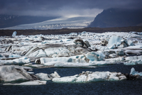 Scenic view of glacial ice in lake and glacier in background, Jokulsarlon, Iceland