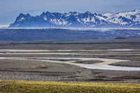 Scenic view of Skeidararsandur and stream with mountains in the background, Nupsvotn, Iceland