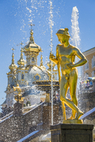 Close-up of a golden statue and the Grand Cascade with Church in background, Peterhof Palace, St. Petersburg, Russia