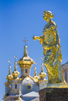 Close-up of golden statue with Church in background, Peterhof Palace, St. Petersburg, Russia