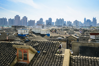 Rooftops with Highrises in the background, Old City of Shanghai, China