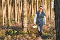 Young Woman Collecting Mushrooms in Scots Pine (Pinus sylvestris) Forest in Early Autumn, Bavaria, Germany