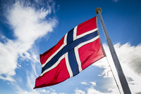 Norwegian Flag and Blue Sky with Clouds