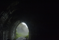 View from Panorma Train Window of Train Tracks and Tunnel, on Route from Ella to Kandy, Sri Lanka
