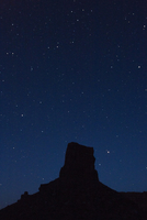 Silhouetted butte against night sky, Valley of the Gods, Utah, USA