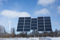 Solar Panels and Wind Turbine in Winter, Wolfe Island near Kingston, Ontario, Canada