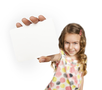 Girl holding a blank card close to camera, studio shot on white background