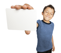 Boy holding a blank card close to camera, studio shot on white background