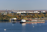 Oil tanker ship on St Lawrence River with Jean Gaulin Refinery, Levis, Quebec, Canada