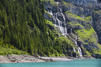 Waterfall cascading into Lake Oeschinensee within the Bernese Alps, mountains above Kandersteg, UNESCO World Heritage Site, Cant