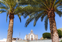 Early 19th century, hilltop church (Iglesia de Santa Lucia) framed by palm trees, Santa Lucia de Tirajana, Gran Canaria, Las Pal