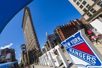 Street scene with the Flatiron Building, New York City, New York, USA