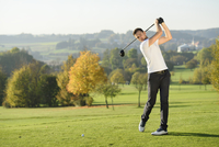 Man Playing Golf on Golf Course in Autumn, Bavaria, Germany