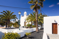 White Washed Village Church framed by Palm Trees, Uga, Lanzarote, Canary Islands