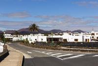Elegant White Washed Houses in front of Volcanic Landscape, Yaiza, Lanzarote, Canary Islands, Spain