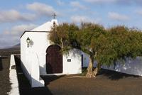 White Washed Ermita de Nuestra Senora de la Caridad nearby Vineyards, La Geria, Lanzarote, Canary Islands, Spain