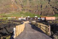 Fence along access to Hotel Punta Grande in front of Steep Mountain, Las Puntas, El Hierro, Canary Islands, Spain