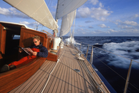 Man Relaxing in Cockpit of Endeavour during Offshore Passage between Bermuda and Antigua