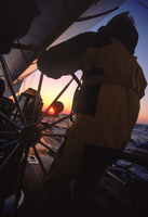Man Helms Endeavour West during Sailing Passage on Pacific Ocean