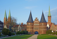 Twin Towers of the Brick Gothic Holstentor City Gate Marking the Western end of the Hanseatic City of Lubeck, Schleswig-Holstein