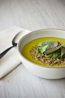 Close-up of Spinach Soup with quinoa, studio shot