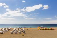 Endless rows of sun umbrellas and sun lounger on the beach,  Puerto del Carmen, Lanzarote, Canary Islands