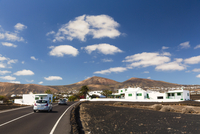 Road by the village of Macher in front of volcanic mountains, Macher, Lanzarote, Las Palmas, Canary Islands