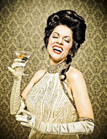 Woman in 1940's fomal attire holding a martini glass and laughing