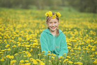 Portrait of Girl Sitting in Meadow in Spring, Upper Palatinate, Bavaria, Germany