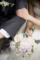 Close-up of Bride's Hand on Groom's Arm