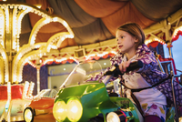 Girl Sitting on Motorcycle of Carousel, Germany