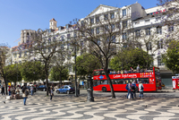 Red sightseeing bus at Praca Dom Pedro IV (Rossio), Downtown, Lisbon, Portugal
