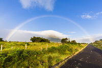 Rural scene with paved road and rainbow above the cloud covered Mount Pico (2351 m), Pico Island, Azores, Portugal