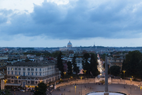 View from Pincio Hill over Piazza del Popolo at dusk with St Peters Basilica in the distance, Rome, Italy