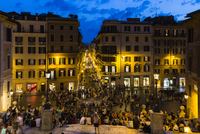 Crowd at the Spanish Steps and Piazza di Spagne illuminated at dusk, Rome, Italy