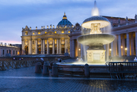 St Peter's Basilica and Square with the Maderno Fountain illuminated at dusk, Vatican City, Rome, Italy