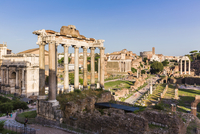 Roman Forum, Arch San Severus, Temple of Saturn and view to the Colosseum, UNESCO World Heritage Site, Rome, Italy