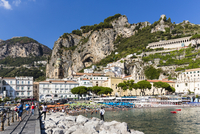 View of the beach and people swimming at Amalfi with the Lattari Mountains in the background, Province of Salerno, Amalfi Coast,