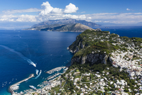 Elevated view of Capri and harbour, with the Sorrento Peninsula in the background, Gulf of Naples, Tyrrhenian Sea, Campania, Ita