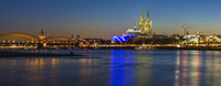 Skyline with Cologne Cathedral, Musical Dome and Hohenzollern Bridge illuminated at dusk, River Rhine, Cologne, Germany