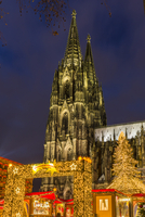Christmas Market at Roncalli Square with the Cologne Cathedral in the background, illuminated at night, Cologne, Germany