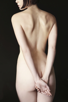 Back view of a nude woman