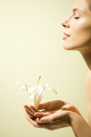 Profile of a Woman Holding White Lily in her Hands