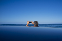 Back View of Man Taking a Photograph of Ocean View