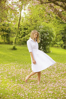 Young Woman Wearing Shirt dress in Garden