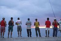 View of few men fishing.