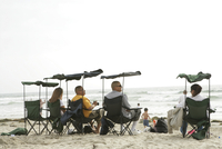 View of a group of people relaxing on a beach.