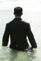 Rear view of a man in the sea.