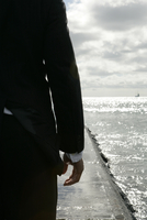 cropped view of a man near the sea.